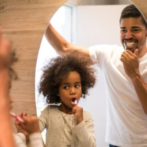 Should you floss before or after brushing? Portrait