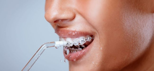 What's the Difference Between a Waterpik and a Water Flosser?